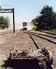 Hi-Rail Tipper discharging ballast along access road - G.Clarke 19th Jan 2002