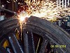 The tyre is cut with the oxy torch during the process to remove the tyre from the wheel. Following tests for any cracks, etc, new tyres will be fitted to the driving and pony truck wheels at the Puffing Billy Workshops - V.Evans 8.6.2004